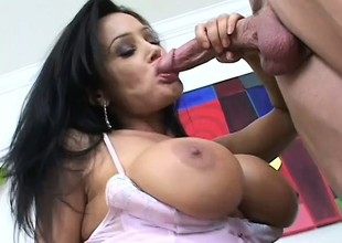 A smoking hot angel caresses her tits as she bounces on a dick