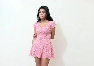 Nice-looking diminutive Latina stripping on camera