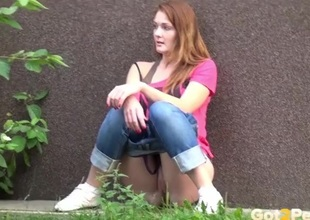 Redhead takes a piss first of all the sidewalk
