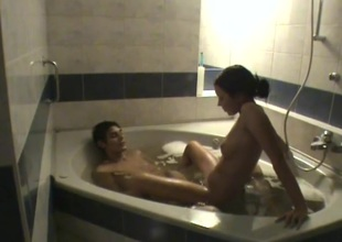 Teen pair filmed as they fool around adjacent to the bathtub