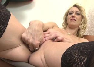 Golden-haired slips two fingers into her adult pussy