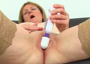 British milf Clare Cream strips wanting and enjoys her vibrator