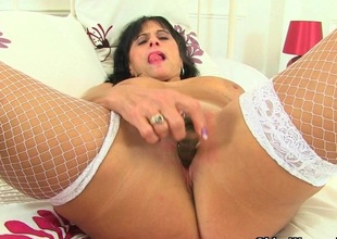 British milf Coloured loves masturbating in fishnet stockings