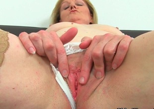British milf Clare Cream strips off and enjoys her copulation toy