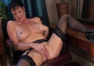 Classy milf beauty with respect to black nylons rubs her sexy cunt