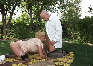 Fine blonde Irish colleen in stockings acquires nailed into the open air